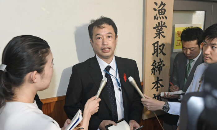 An official of the Japanese Fisheries Agency speaks to media following a collision between its patrol boat and a North Korean fishing boat, in Tokyo Monday, Oct. 7, 2019. (Mizuki Ikari/Kyodo News via AP)