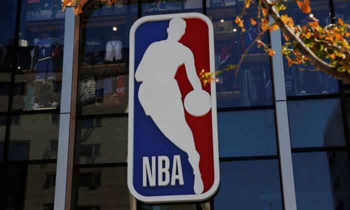 An NBA logo is seen on the facade of its flagship store at the Wangfujing shopping street in Beijing, China, on Oct. 8, 2019. (Tingshu Wang/Reuters)