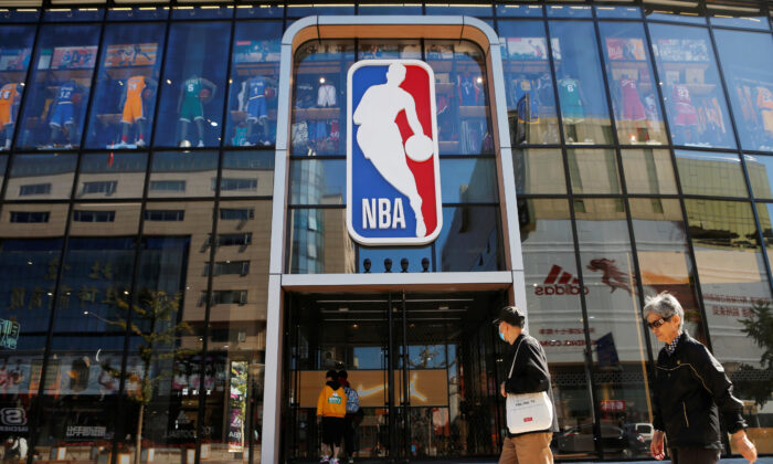 People enter an NBA store on the Wangfujing shopping street in Beijing on Oct. 8, 2019. (Reuters/Tingshu Wang)