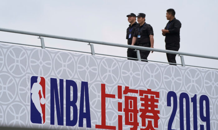 Security personnel are seen at the venue that was scheduled to hold fan events ahead of an NBA China game between Brooklyn Nets and Los Angeles Lakers, at the Oriental Sports Center in Shanghai, China on Oct. 9, 2019. (Aly Song/Reuters)