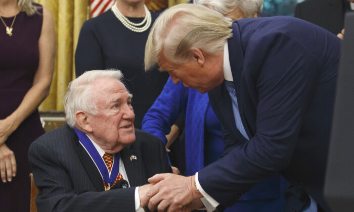 President Donald Trump presents the Presidential Medal of Freedom to former Attorney General Edwin Meese, in the Oval Office of the White House, Washington, on Oct. 8, 2019. (AP Photo/Alex Brandon)