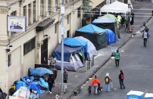 People walk in Skid Row in Los Angeles