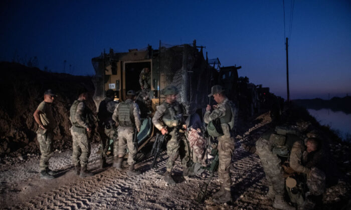 First group of Turkish infantry prepare to enter Syria on the border between Turkey and Syria in Akcakale, Turkey on Oct. 9, 2019. (Burak Kara/Getty Images)