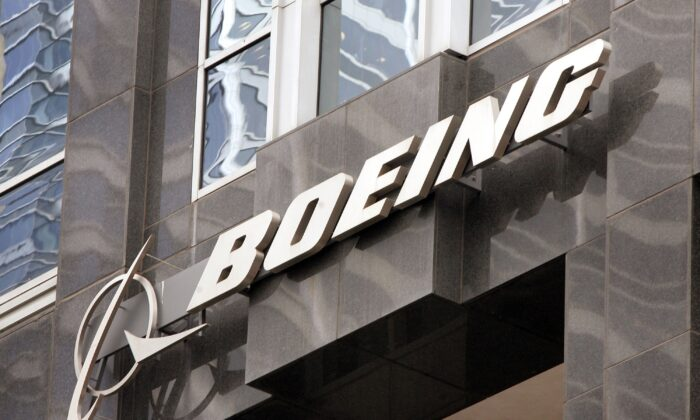 The Boeing logo hangs on the corporate world headquarters building of Boeing in Chicago, Ill. on Nov. 28, 2006. (Scott Olson/Getty Images)