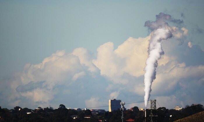 A smoke stack emits fumes in Sydney Australia on June 2, 2007. (Ian Waldie/Getty Images)