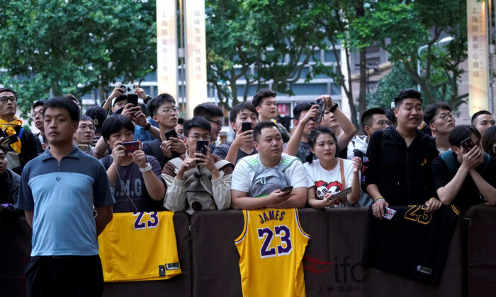 NBA fans wait outside a Ritz-Carlton hotel in Shanghai, China on Oct. 9, 2019. (Aly Song/Reuters)