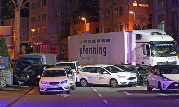 In this Monday, Oct. 7, 2019 photo, a truck stands between damaged cars in Limburg, Germany.(Thorsten Wagner/dpa via AP)