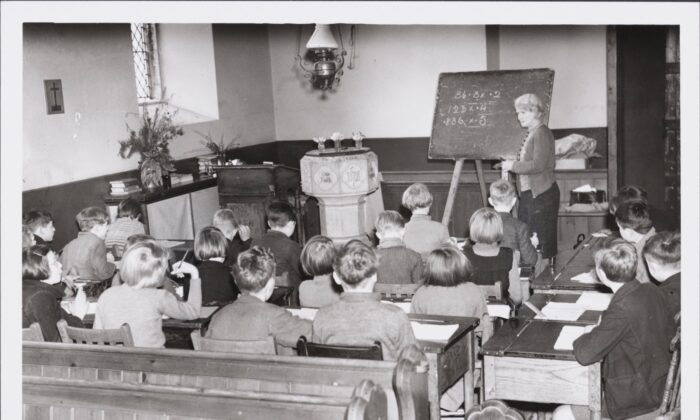 School in a church. Children evacuated from West Ham and Birmingham are using All Saints Church, Bishopswood, Ross on Wye, as a schoolroom, because of lack of accommodation in the school. The church is situated in the heart of the woods in Wye Valley, and when the weather is suitable, the children have their lessons outdoors. (Photo by Hulton Archive/Getty Images)