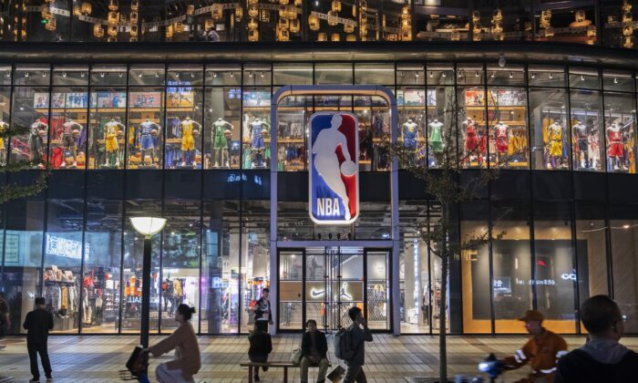 People walk by and sit outside the NBA flagship retail store in Beijing, China on Oct. 9, 2019. (Kevin Frayer/Getty Images)