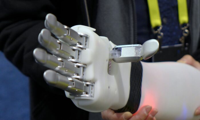 "The ""prosthetic hand"" from BrainRobotics, controlled by signals sent from the residual muscles on an amputee's limb, a process that involves some machine learning technology, is displayed at the 2017 Consumer Electronic Show (CES) in Las Vegas, Nevada on January 7, 2017. SOPHIE ESTIENNE/AFP/Getty Images"