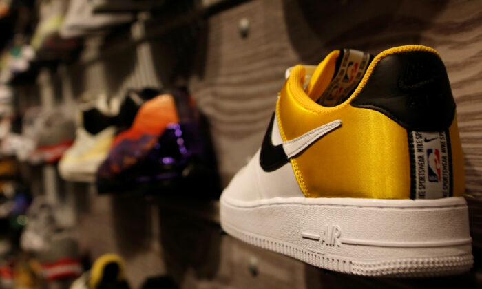 A pair of Nike's Air Force shoes with a NBA logo are displayed at a Nike store in Beijing, China, on Oct. 10, 2019. (Tingshu Wang/Reuters)