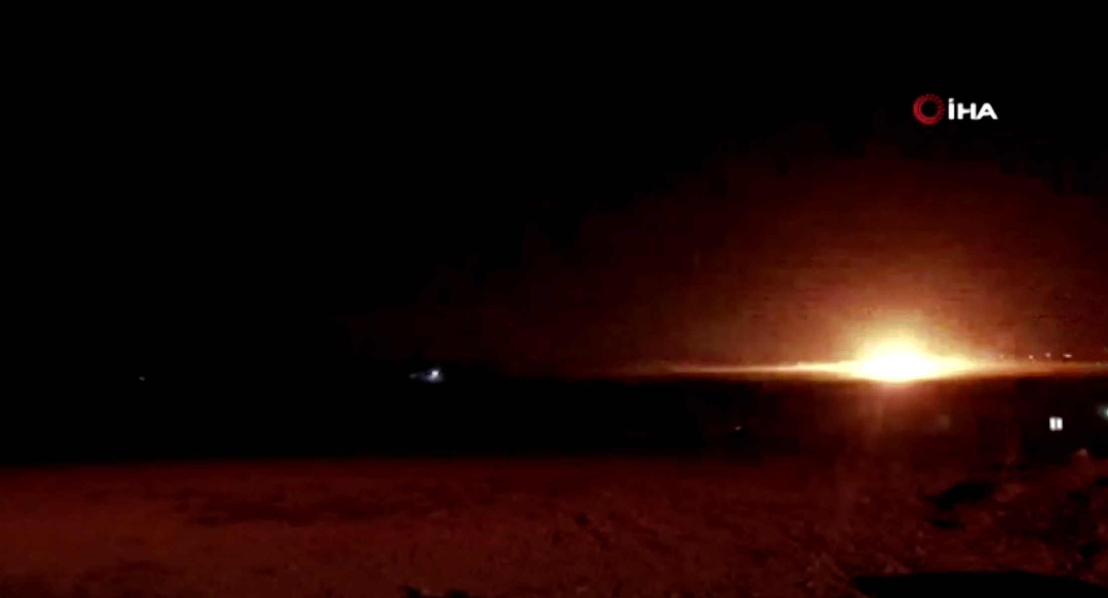 A blast is seen near the border between Syria and Turkey, as seen from Akcakale