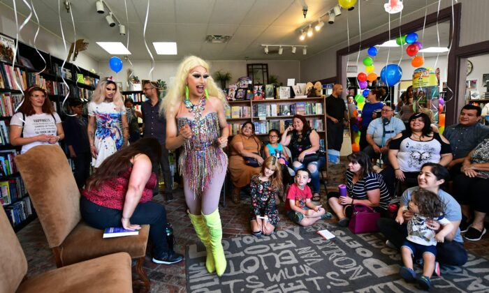Drag queens Athena Kills (C) and Scalene Onixxx arrive to awaiting adults and children for Drag Queen Story Hour at Cellar Door Books in Riverside, Calif. on June 22, 2019. (Frederic J. Brown/AFP/Getty Images)