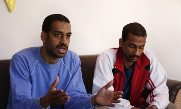 Alexanda Amon Kotey (L) and El Shafee Elsheikh, speak at a security center in Kobani, Syria, in a file photograph. (Hussein Malla, File/AP Photo)