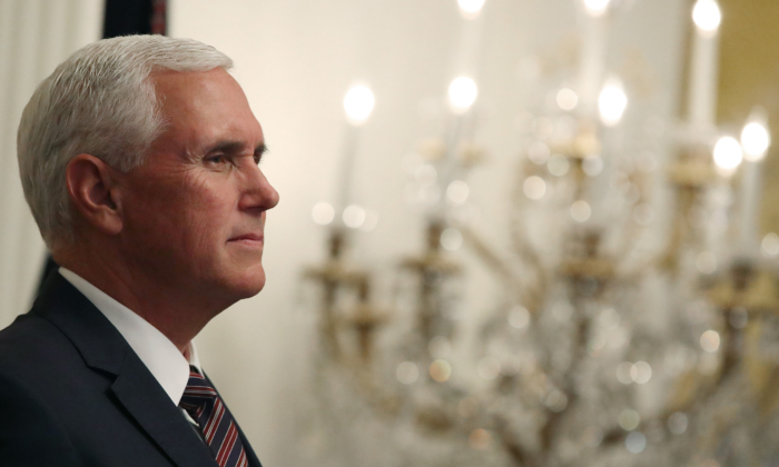 Vice President Mike Pence listens to President Donald Trump speak during a reception to honor Hispanic Heritage Month, in The East Room at the White House on Sept. 27, 2019 in Washington. (Mark Wilson/Getty Images)