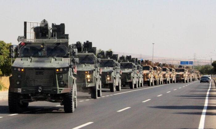 A Turkish miltary convoy is pictured in Kilis near the Turkish-Syrian border, Turkey, Oct. 9, 2019. (Mehmet Ali Dag/ Ihlas News Agency (IHA) via Reuters)
