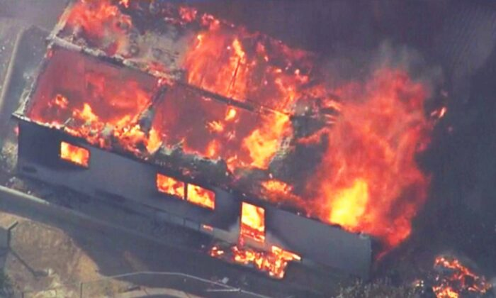 This photo from video provided by KABC-TV shows strong, gusting winds pushing flames through the Villa Calimesa mobile home park in Calimesa, Calif., southeast of San Bernardino on Oct. 10, 2019. (KABC-TV via AP)