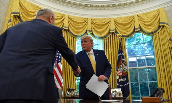 Chinese Vice Premier Liu He (L) hands over a letter of Chinese leader Xi Jinping to President Donald Trump at the Oval Office of the White House in Washington, on Oct. 11, 2019 (NICHOLAS KAMM/AFP via Getty Images)