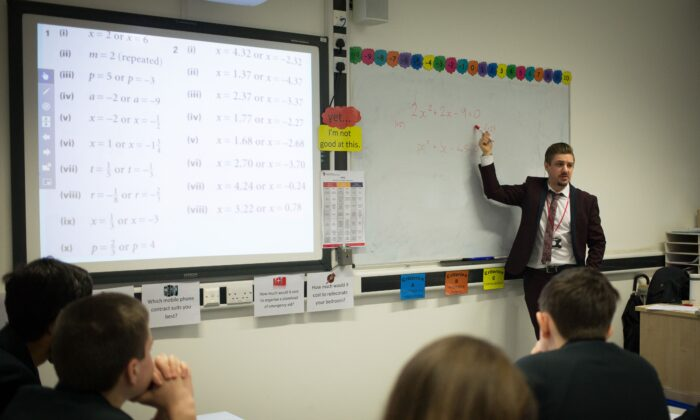 Researching better ways of helping students learn how to read and write and how to solve problems in mathematics is a good use of time and money. (Matt Cardy/Getty Images)