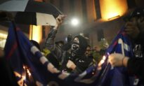 Anti-Trump Protesters in Minneapolis Burn American Flag, MAGA Hats