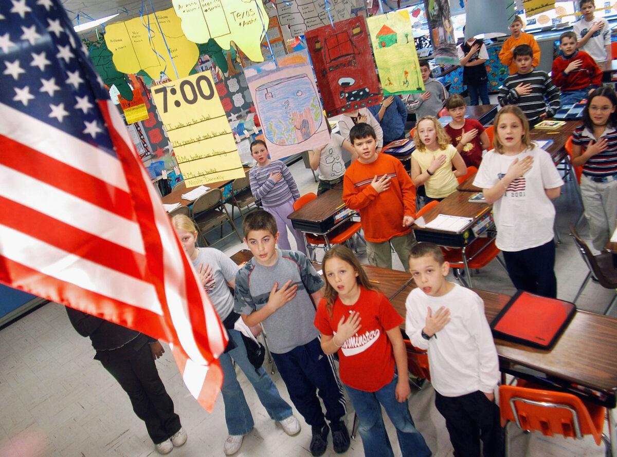 Teacher Reassigned Duties to Avoid Pledge of Allegiance After Complaints Over Kneeling