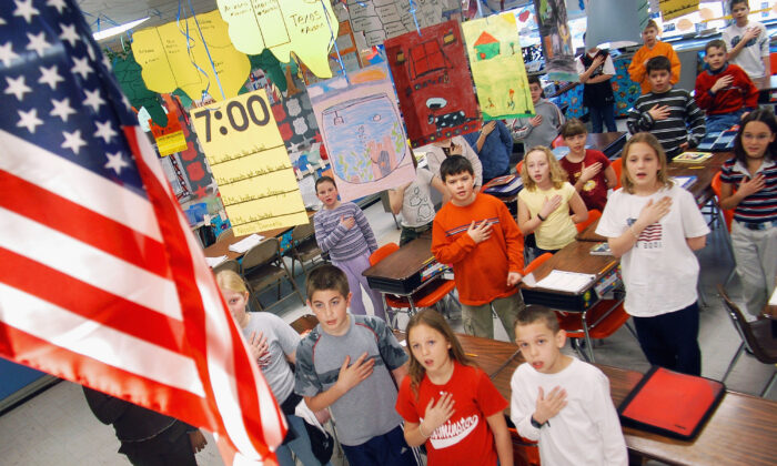 In this file image, fourth graders pledge allegiance to the flag in a Pennsylvania elementary school on March 24, 2004. (William Thomas Cain/Getty Images)