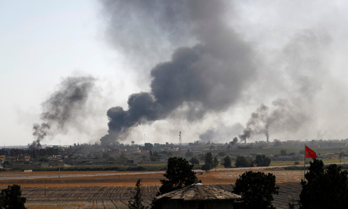 Smoke rises over Tel Abyad, Turkey