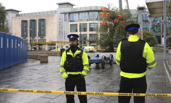 Police outside the Arndale Centre in Manchester, England on Oct. 11, 2019, after a stabbing incident at the shopping center that left five people injured.(Peter Byrne/PA via AP)