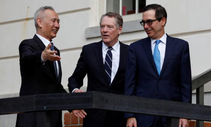 U.S. Treasury Secretary Steve Mnuchin (R) and Trade Representative Robert Lighthizer welcome China's Vice Premier Liu He before the two countries' trade negotiations in Washington, D.C., on Oct. 10, 2019. (Yuri Gripas/Reuters)