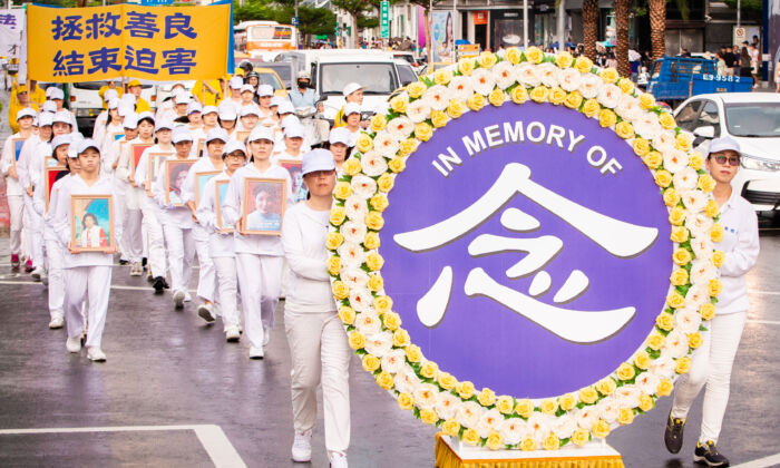 Falun Gong practitioners march in commemoration of the 20th anniversary of the ongoing persecution in China, in Taipei, Taiwan, on July 20, 2019. (Chen Po-chou/The Epoch Times)