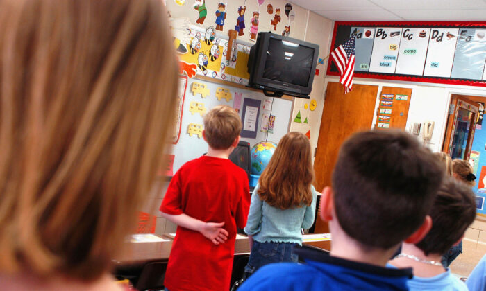 In this file image fourth graders pledge allegiance to the flag in a Pennsylvania elementary School on March 24, 2004. (William Thomas Cain/Getty Images)