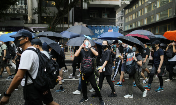 Anti-government demonstrators march in protest against the invocation of the emergency laws in Hong Kong, China, Oct. 12, 2019. (Reuters/Ammar Awad)