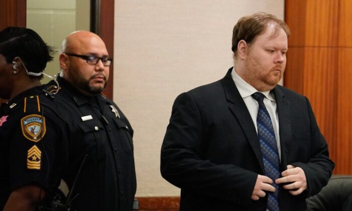 Ronald Lee Haskell is escorted into court in Houston, Texas on Oct. 11, 2019. ( Melissa Phillip/Houston Chronicle via AP)
