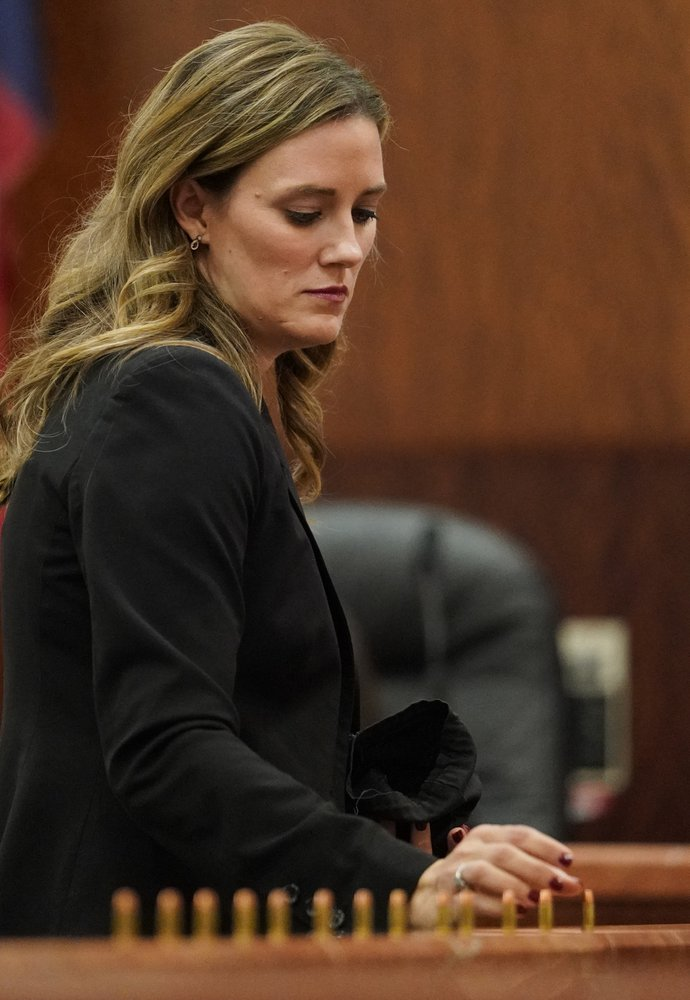 Samantha Knecht, prosecutor, places bullets in front of the jury