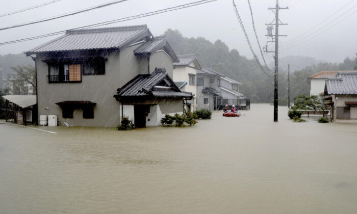 Heavy rains caused by Typhoon Hagibis flood a residential area in Ise, central Japan, in this photo taken by Kyodo on Oct. 12, 2019. (Courtesy of Kyodo/via Reuters