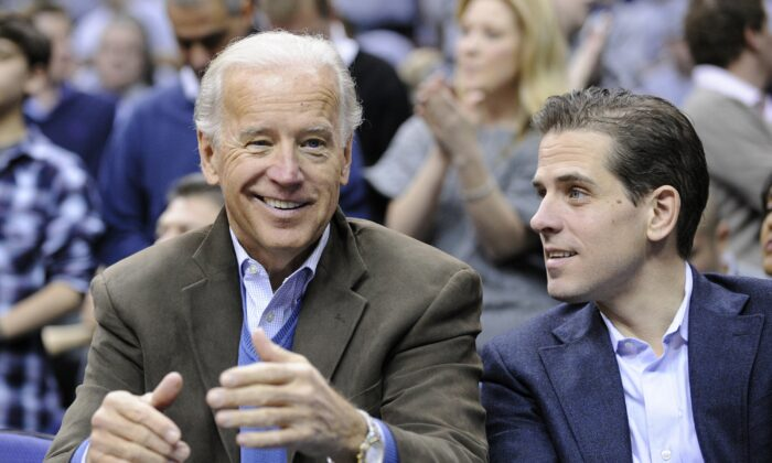 Former U.S. vice president Joe Biden (L) with his son Hunter at the Duke Georgetown NCAA college basketball game in Washington on Jan. 30, 2010. (Nick Wass/AP Photo)