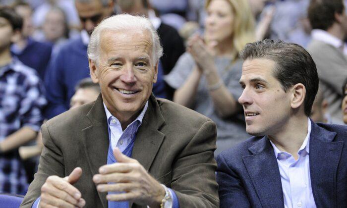 Then-Vice President Joe Biden, left, with his son Hunter at the Duke Georgetown NCAA college basketball game in Washington on Jan. 30, 2010. (Nick Wass/AP Photo)