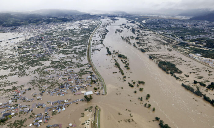 An aerial view shows residential areas flooded by the Chikuma river following Typhoon Hagibis in Nagano, central Japan, on Oct. 13, 2019. (Kyodo/via REUTERS)
