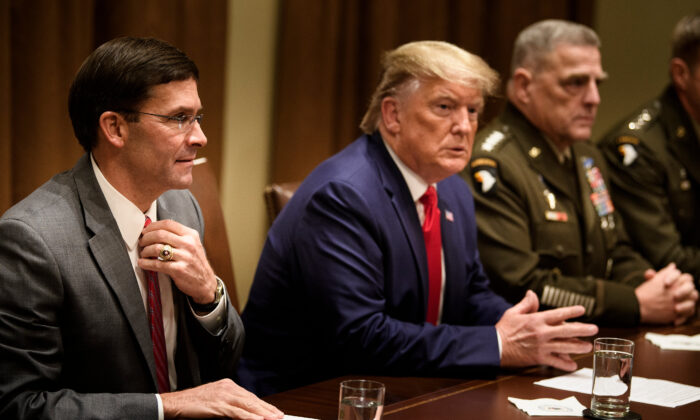 Secretary of Defense Mark Esper (L), President Donald Trump, and Chairman of the Joint Chiefs of Staff Army General Mark A. Milley (R) in the Cabinet Room of the White House in Washington on Oct. 7, 2019. (BRENDAN SMIALOWSKI/AFP via Getty Images)
