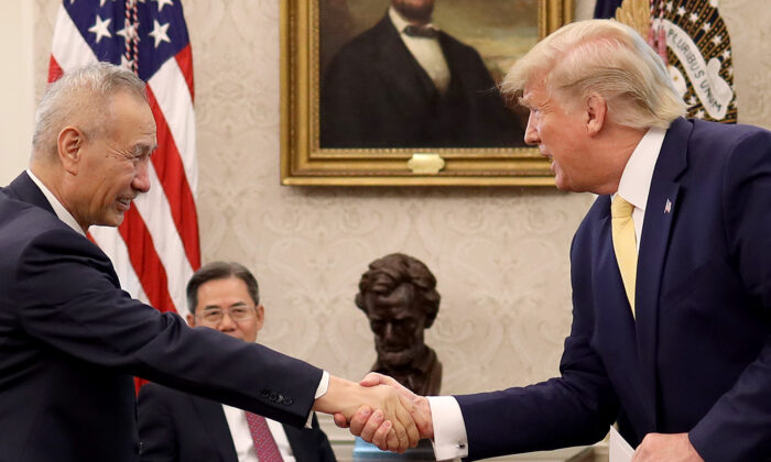 """President Donald Trump shakes hands with Chinese Vice Premier Liu He after announcing a """"phase one"""" trade agreement with China in the Oval Office at the White House Oct. 11, 2019 in Washington. (Win McNamee/Getty Images)"""