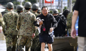 Japan Sends Troops After Deadly Typhoon Floods Towns, Threatens More Damage