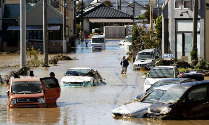 Vehicles are seen in mud water as Typhoon Hagibis hit the city in Sano, Tochigi prefecture, on Oct. 13, 2019. (Kyodo News via AP)