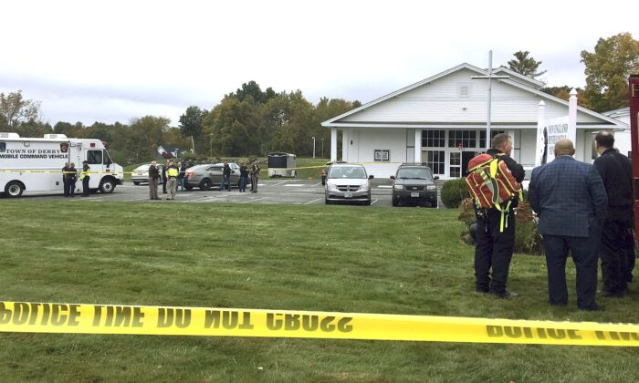 Police stand outside the New England Pentecostal Church after reports of a shooting in Pelham, N.H. on Oct. 12, 2019. (Siobhan Lopez/WMUR-TV via AP)