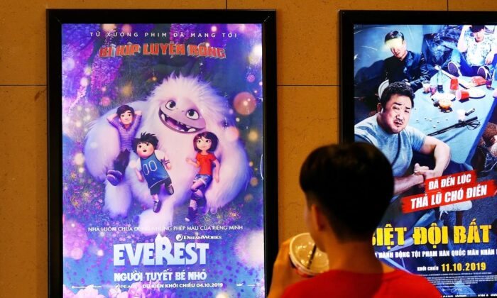 "A boy looks at a poster for the animated movie ""Everest Nguoi Tuyet Be Nho"", also known as ""Abominable"", at a movie theatre in Hanoi on Oct. 14, 2019. (Nhac Nguyen/AFP via Getty Images)"