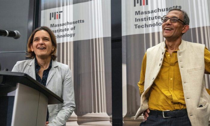 Esther Duflo, left, and Abhijit Banerjee along with Harvard's Michael Kremer, were awarded the 2019 Nobel Prize in economics for pioneering new ways to alleviate global poverty. (Michael Dwyer/AP)