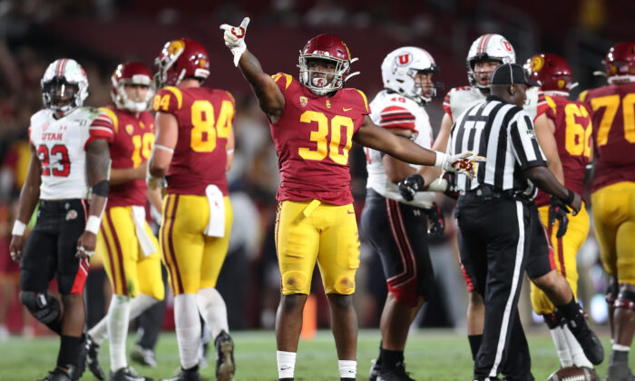 Running back Markese Stepp #30 of the USC Trojans reacts to his play earning a first down against the Utah Utes at Los Angeles Memorial Coliseum in Los Angeles on Sept. 20, 2019. (Meg Oliphant/Getty Images)