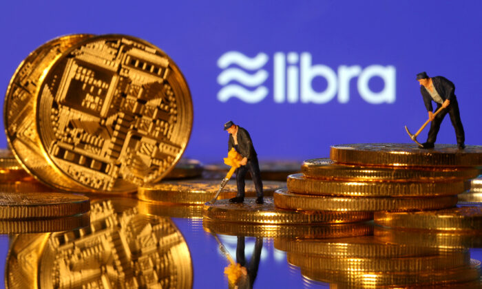 Small toy figures are seen on representations of virtual currency in front of the Libra logo in this illustration picture, June 21, 2019. (Dado Ruvic/File Photo)
