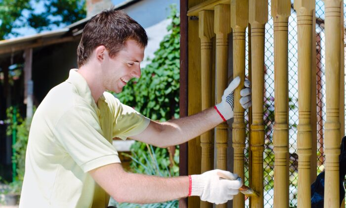 Even the grueling task of stripping and repainting a fence or railing can offer genuine fulfillment—if our mind is right. (Lithiumphoto/Shutterstock)