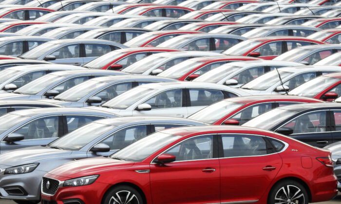 Cars for export wait to be loaded onto cargo vessels at a port in Lianyungang, Jiangsu Province, China on Oct. 14, 2019.  (Reuters)