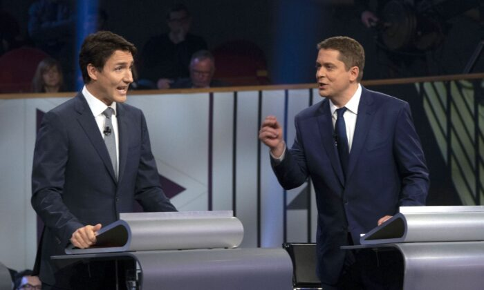 Liberal leader Justin Trudeau and Conservative leader Andrew Scheer take part in the the Federal leaders French-language debate in Gatineau, Que., on Oct. 10, 2019. (THE CANADIAN PRESS/Adrian Wyld)